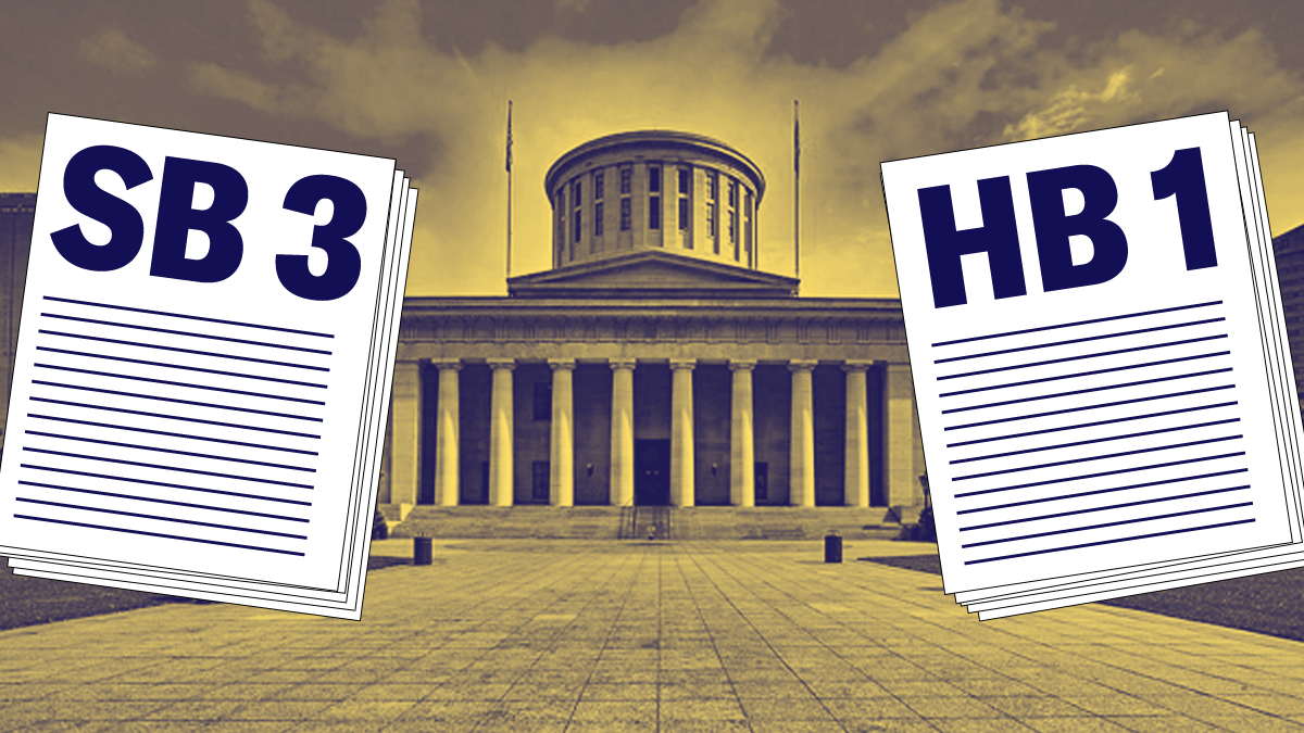 SB3 and HB1 stacks of paper, in front of the Ohio Statehouse