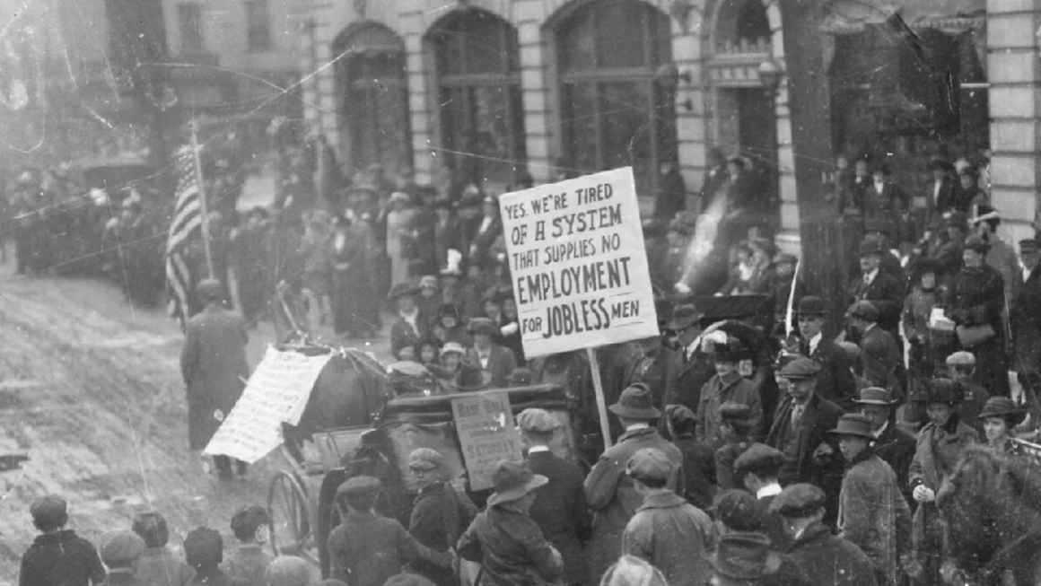 Coxey's Army Protest steps off in Massillon, Ohio. Sign: Yes, we're tired of a system that supplies no employment for jobless men