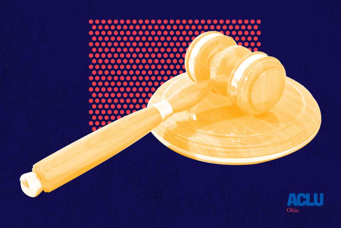 Gavel laying on its side with an orange color overlay on a red dot pattern on a textured navy background